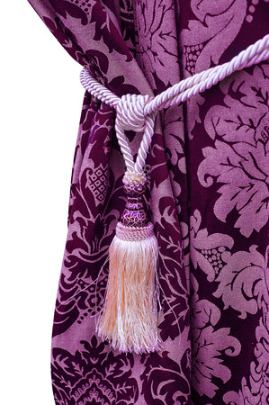 curtain background: purple curtain with tassel decoration on white background.
