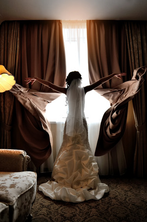 bride throwing her hands in silhouette blinds.