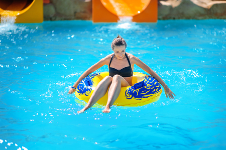 water   slide: Beautiful girl riding a water slide.