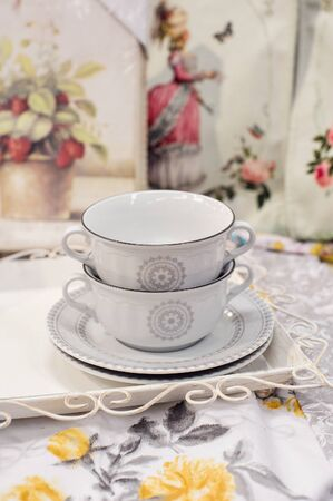 saucers: Two beautiful white cups and saucers.