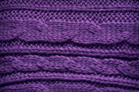 garments: texture of knitted garments purple.