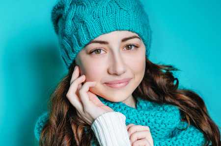 portrait of a beautiful young woman in a hat with a menthol color.