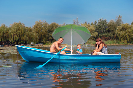 family riding on a boat in the summer. Stock Photo - 43013403