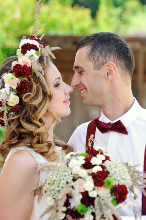 romantic flowers: Bride and groom at wedding Day walking Outdoors on spring nature