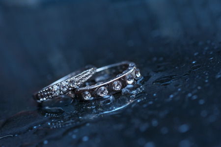 jewelle: two wedding rings on a blue background.