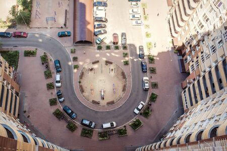 new car lot: Aerial view of the lot of cars near building. Stock Photo