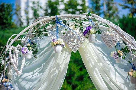 creatively: Fragment of creatively decorated wedding arch with natural flowers