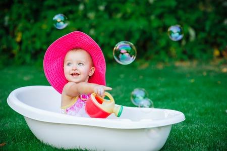 child bath: child bathing  with foam bath. Stock Photo