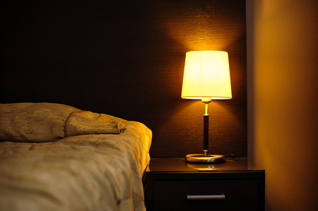 reading lamps in the bedroom near the bed. Stockfoto