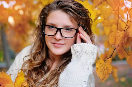 Portrait of beautiful woman wearing fashion glasses during the autumn.