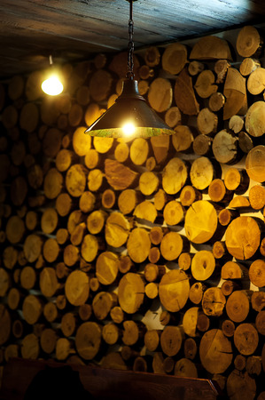 wooden panel: beautiful decor wall of wooden logs. Stock Photo