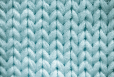 Blue knitted textured background close up. Foto de archivo