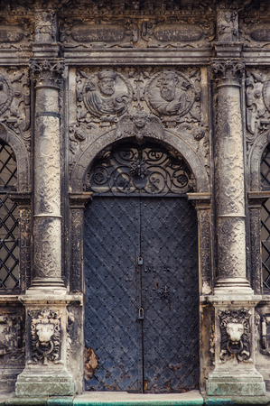 stone of destiny: Black metal doors and two pillars on each side in a church. Stock Photo