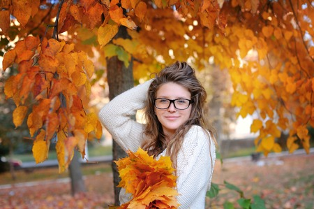 Portrait of beautiful woman wearing fashion glasses during the autumn. Stock Photo - 43705495