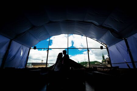 loving couple: silhouette of a loving couple against the window. Stock Photo