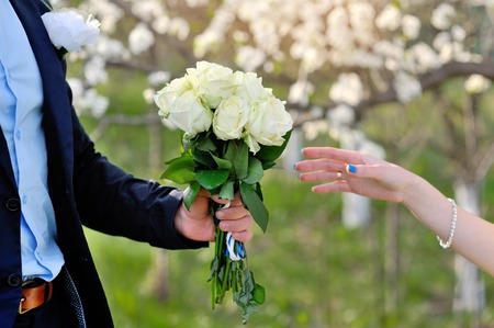 gives: groom gives the bride a beautiful wedding bouquet.