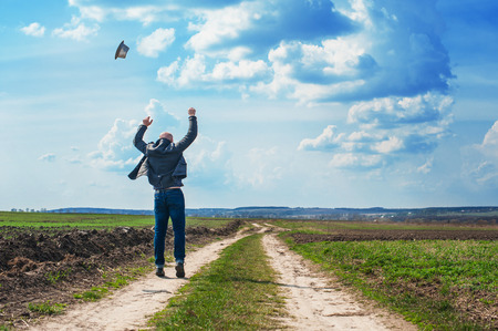 1 person: man walks along a dirt road and enjoy the freedom.
