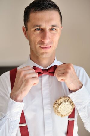 red tie: groom wears a red tie Stock Photo