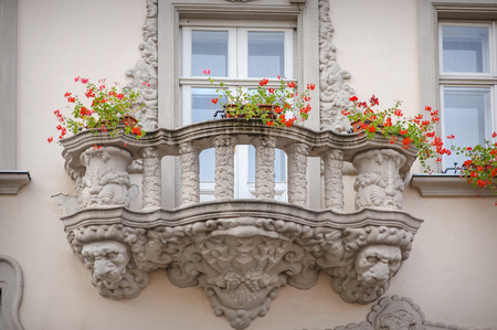 garret: Beautiful balcony in a classic style with flowers.