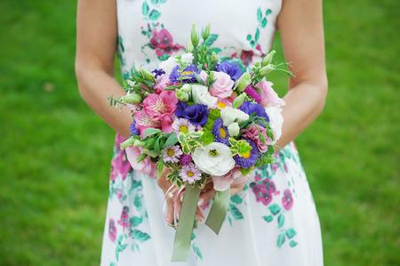 wedding couple: Bride holding beautiful wedding bouquet.