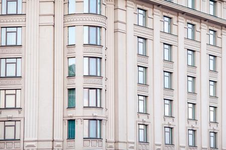 many windows: Architecture multi-storey building with many windows.