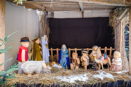 joseph: christmas nativity scene of jesus birth in an old cottage nearby bethlehem with joseph, mary and shepherd