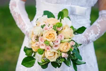 Bride holding a beautiful wedding bouquet. Stock Photo