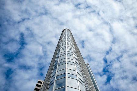 sky scraper: skyscraper on a background of clouds.