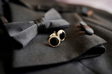 tailor suit: Accessories butterfly and cufflinks for a classic suit. Stock Photo