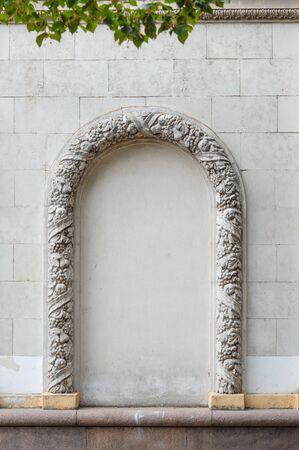 decorates: Arch molding decorates on the plain concrete wall. Stock Photo