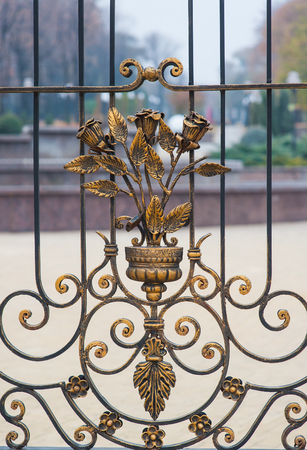 smithery: Metal wrought-iron gates with floral patterns.