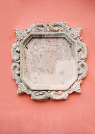 moldings: Beautiful ornate white decorative plaster moldings on red wall.