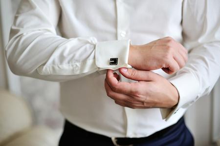 cufflink: men wear a shirt and cufflinks