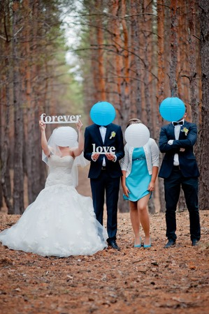 witnesses: groom, bride and witnesses walking in autumn pine forest Stock Photo
