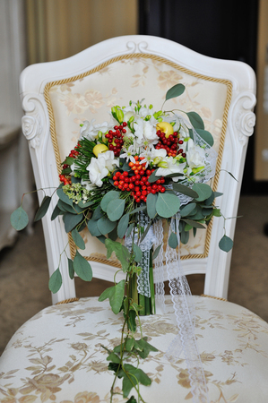 red gerber daisy: bridal bouquet lying on the chair