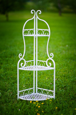 galvanised: Decorative white stand on green grass