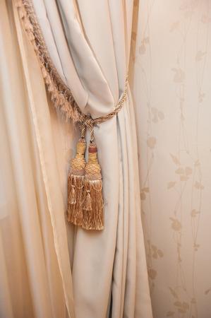 draped: Part of beautifully draped curtain.
