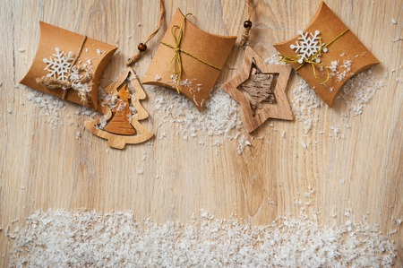 Christmas gifts in kraft paper with a homemade toys with snow.