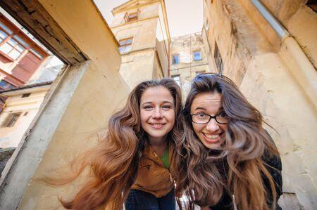 lviv: Two happy women walking in old Lviv.