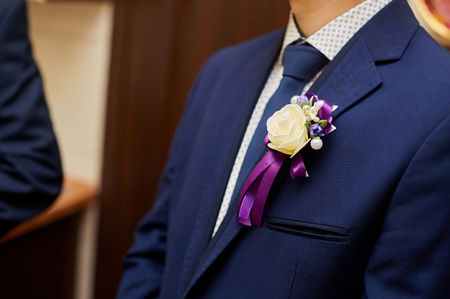 buttonhole: Groom in a jacket with a buttonhole.