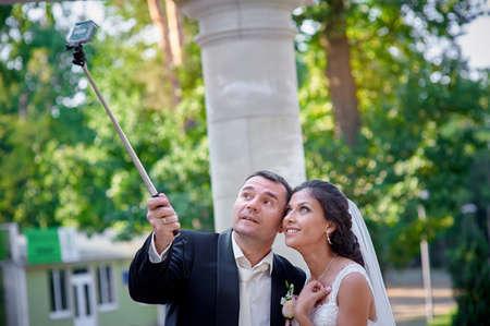 selfy: Happy stylish smiling couple walking and make selfy.
