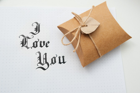 god box: Text god bless you on paper texture and gift box with heart.