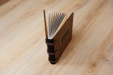 wedding book with a wooden cover on a wooden texture.