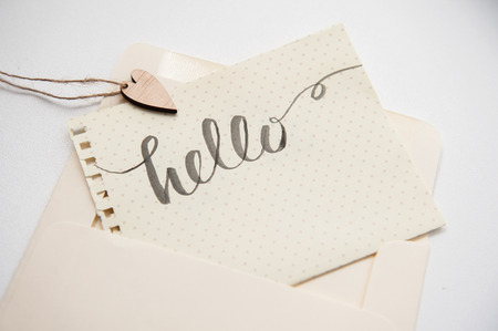 greating card: calligraphic inscription hello and heart for greating card.