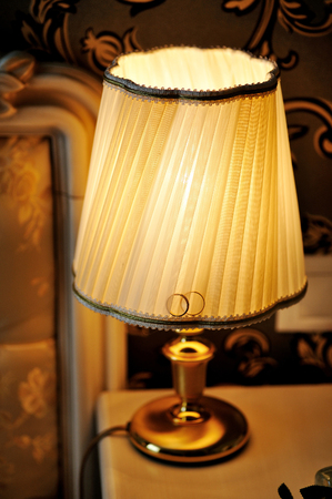 bedside lamp: lamp on the bedside table in the bedroom.