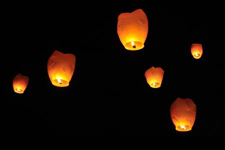 sky lantern: People is launching sky lantern to the sky. Stock Photo