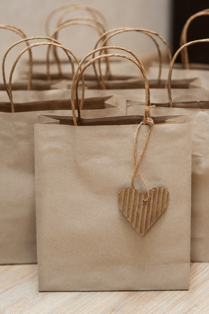 Brown craft paper bags for gifts on background.