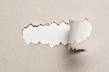uncovering: paper texture with torn half piece of middle and place for text.