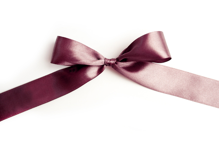 shimmery: brown ribbon with a bow on white background. Stock Photo