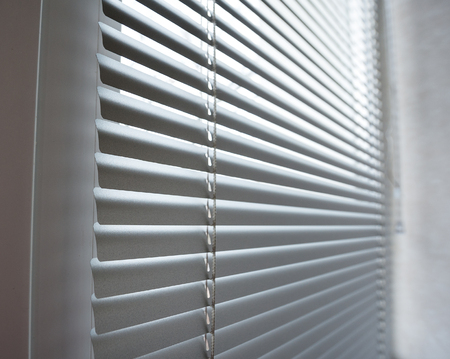 the shutter: close-up modern plastic Shutter Blinds in room. Stock Photo